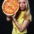 Beautiful young woman eating pizza — Stock Photo #4302746