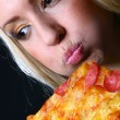 Beautiful young woman eating pizza — Stock Photo