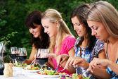 Group of beautiful girls drinking wine — Stock Photo