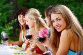 Group of beautiful girls drinking wine — Stok fotoğraf