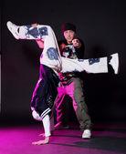 Hip hop dancers in dance — Stock Photo