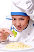 Funy chef eating fresh pasta — Stock Photo