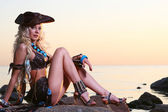 Beautiful blond woman in pirate image — Stock Photo