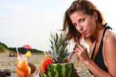 Young and attractive lady drink fresh fruit cocktail — Stock Photo