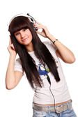 Beautiful young and sexy girl with headphones — Stock Photo