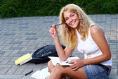 Young attractive student reading the book — Stock Photo