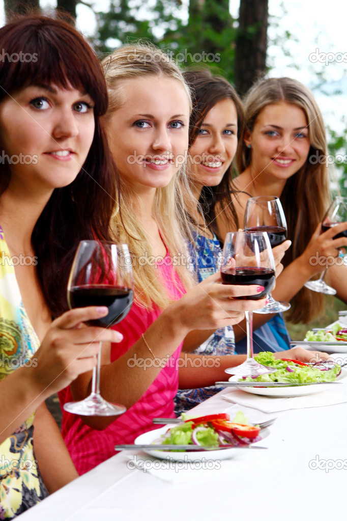 Group of beautiful woman drinking wine — Stock Photo #4300806