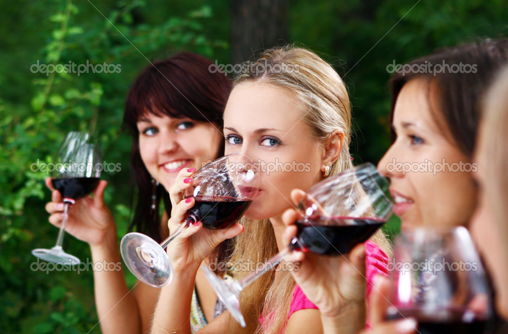 Group of beautiful woman drinking wine — Stock Photo #4300828