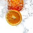 Oranges dropped into water — Stock Photo