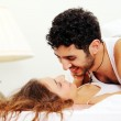 Young couple in bed — Stock Photo