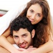 Young couple in bed — Stock Photo #4643604