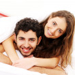 Young couple in bed — Stock Photo #4643611