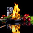 Stock Photo: Frying pwith burning fire inside