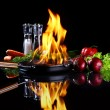 Frying pan with burning fire inside — Stock Photo
