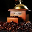 Coffee mill on the table with coffee beans around — Stock Photo
