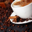 Coffee cup on table with coffee beans around — Stock Photo #4689385