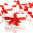 Gift envelope with awesome red bow — Stock Photo