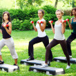 Stock Photo: young and attractive womans doing fitness exercises