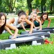 young and attractive womans doing fitness exercises — Stock Photo