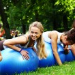 Young and attractive womans doing fitness exercises - Stok fotoğraf