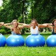 Young and attractive womans doing fitness exercises — Stock fotografie