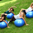 Young and attractive womans doing fitness exercises - Stock Photo