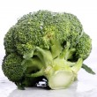 Fresh broccoli on white background - Stock Photo