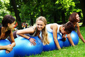 Young and attractive womans doing fitness exercises — Stok fotoğraf