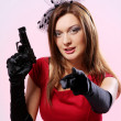 Attractive and sexy spy woman with pistol — Stock Photo