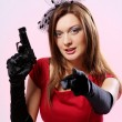 Attractive and sexy spy woman with pistol - Stock Photo