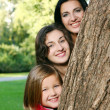 Young family in autumn park — Stock Photo #5018614
