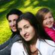 Young family taking in the autumn park — Stock Photo