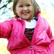 Little girl in autumn park — Stock Photo #5018676