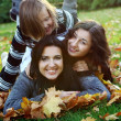 Stock Photo: Young family taking in the autumn park