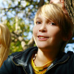 Attractive blonde boy in park — Stock Photo