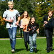 Happy family have fun in park — Stock Photo