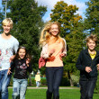 Happy family have fun in park — Stock Photo #5019064