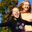Two happy sisters have fun in park — Stock Photo