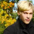 Attractive blonde boy in park — Stock Photo #5019118