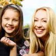 Two sisters have fun in park — Stock Photo