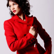 Young woman in red coat — Stock Photo