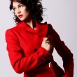 Young woman in red coat — Stock Photo #5019268