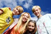 Happy family at background of sky — Stock Photo