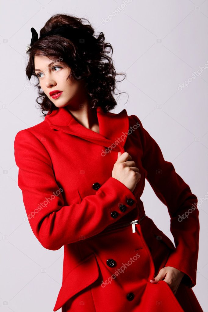 Young woman in red coat — Stock Photo © yekophotostudio 5019268