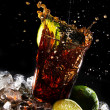 Fresh cola drink with green lime - Stock Photo
