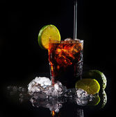 Fresh cola drink with green lime — Stock Photo