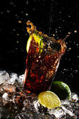 Fresh cola drink with green lime — Stok fotoğraf
