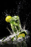 Fresh drink with green lime — Stock Photo