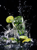 Fresh drink with green lime — Stok fotoğraf