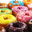 Colorful and tasty donuts - Stock Photo